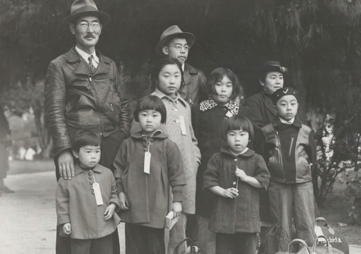 Members of the Mochida family awaiting evacuation. Dorothea Lange for the United States Department of the Interior, War Relocation Authority. Courtesy of the Bancroft Library, University of California, Berkeley.