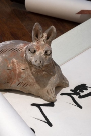 Rabbit positioned with a calligraphy scroll by John Niblack