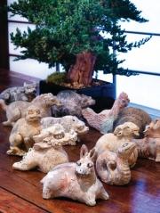 Tang Dynasty ceramic zodiac animals with a bonsai tree.