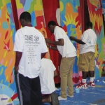 Boys & Girls Club teens collaborate with Sharon Koskoff to paint huge mural panels in the Bill Bailey Community Center gymnasium in Belle Glade
