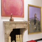 Rothko's Reds hangs beside Frances Bacon's Self Portrait (1961); a Han Dynasty horse sits on the mantel