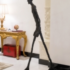 Walking Man I (1960), Alberto Giacometti; the artist was a favorite of Ronnie's late husband, Samuel