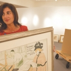 Boca Raton Museum of Art Curator Marisa Pascucci with a lithograph by Henri de Toulouse-Lautrec. (Gift of Dr. Mark Plon in memory of Azik Plon)