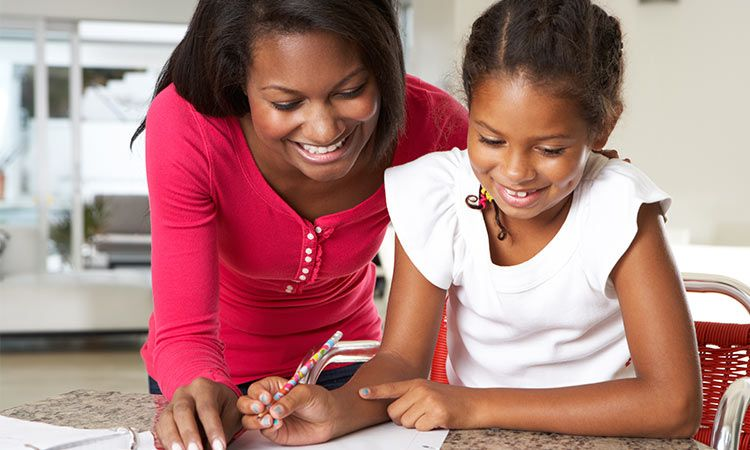 girl drawing with parent